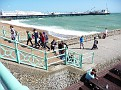 People walking up steps from the East Street Groyne with the Palace Pier in the distance, 2, JUL 2011