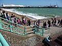 People walking up steps from the East Street Groyne with the Palace Pier in the distance, 1, JUL 2011