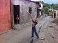 Trying to get his ball of the roof.  Village life in Alotenango, Guatemala.