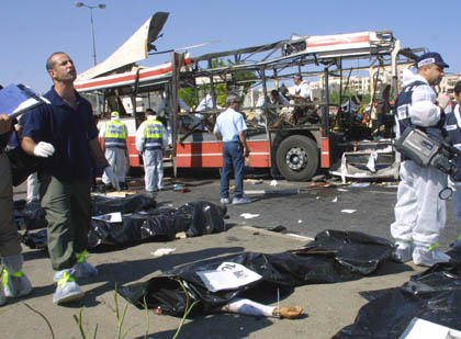 19 people were killed and 74 injured in an Israeli bus suicide bombing. The bus, which was completely destroyed, was carrying many students on their way to school.