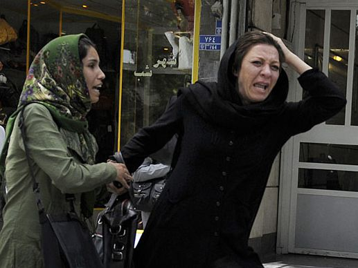 A day after the vote, a woman cries near Musavis campaign headquarters in Tehran.