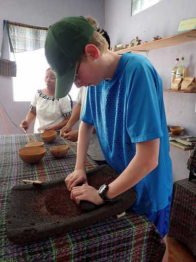 grind the beans on metate