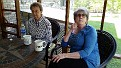 Jean & Gail having coffee on our back porch.