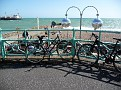 Bicycles against the railing with the Palace Pier in the distance, 1, JUL 2011