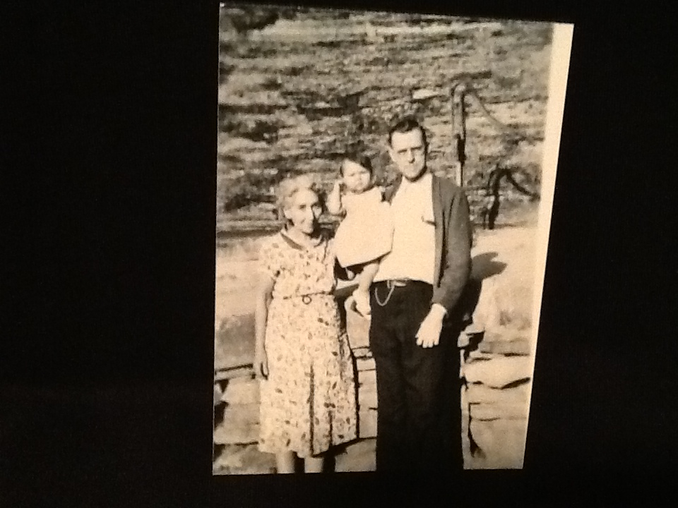 """John Burlin Jeffers and Kizzie Ann (DUNCAN) Jeffers holding Judith Ann """"Judy"""" Phillips, at the store in Norma."""