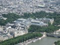 Paris View from the top of the Eiffel Tower.  Glass building = Grand Palais.
