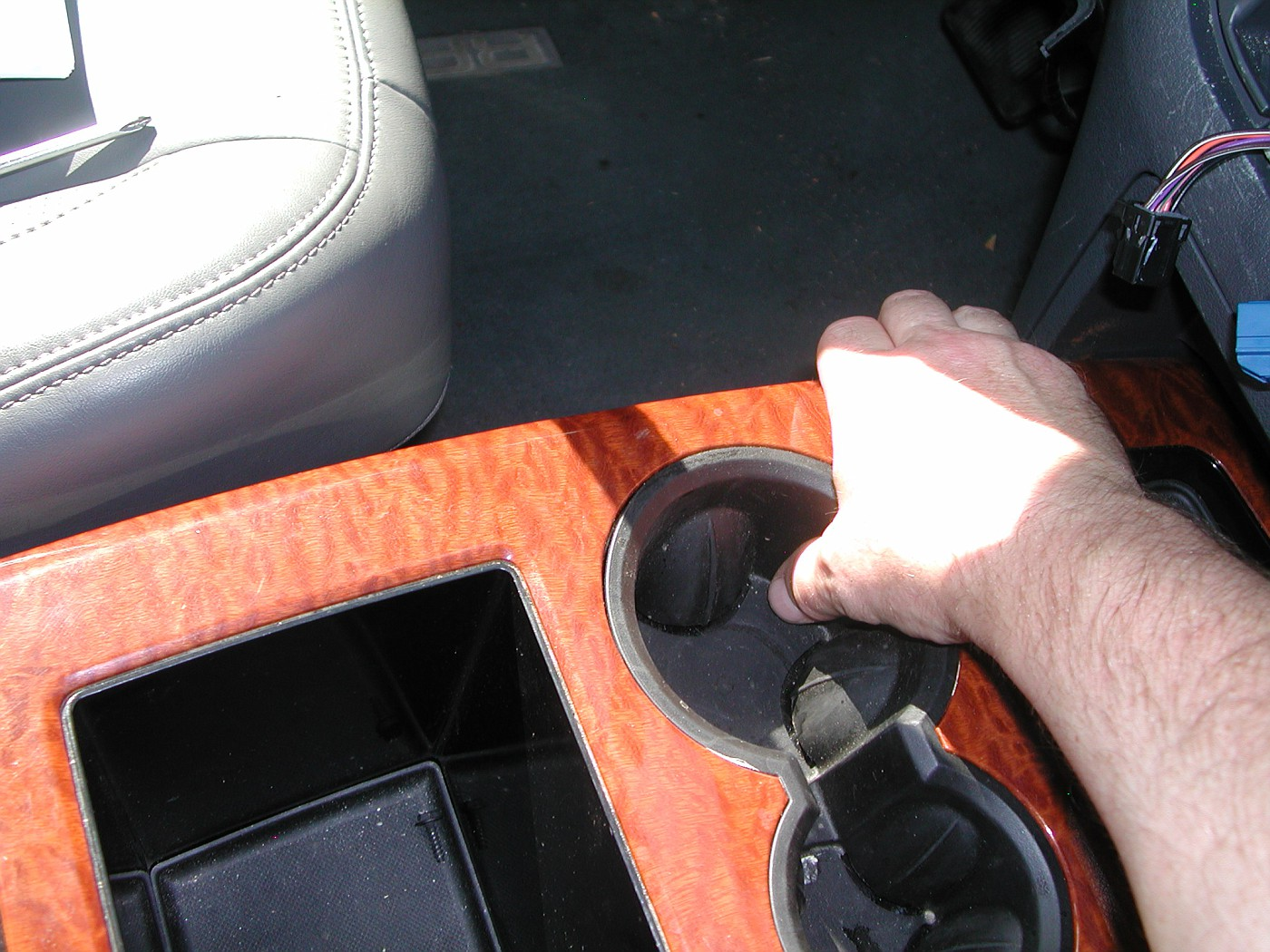 Remove center console upper trim pan by pulling up on the edges 1st