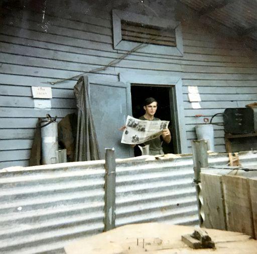 49-Roy Schmasow reading the Newspaper.